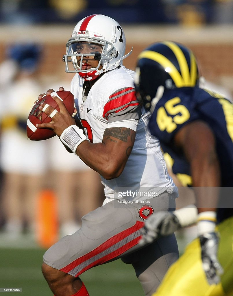 <a gi-track='captionPersonalityLinkClicked' href=/galleries/search?phrase=Terrelle+Pryor&family=editorial&specificpeople=4420918 ng-click='$event.stopPropagation()'>Terrelle Pryor</a> #2 of the Ohio State Buckeyes looks to throw a fourth quarter pass behind Obi Ezeh #45 of the Michigan Wolverines on November 21, 2009 at Michigan Stadium in Ann Arbor, Michigan. Ohio State won the game 21-10.