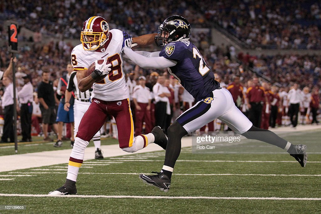 Terrence Austin #18 of the Washington Redskins scores a touchdown against <a gi-track='captionPersonalityLinkClicked' href=/galleries/search?phrase=Tom+Zbikowski&family=editorial&specificpeople=572502 ng-click='$event.stopPropagation()'>Tom Zbikowski</a> #28 of the Baltimore Ravens during the second half of a preseason game at M&T Bank Stadium on August 25, 2011 in Baltimore, Maryland. The Ravens defeated the Redskins 34-31.