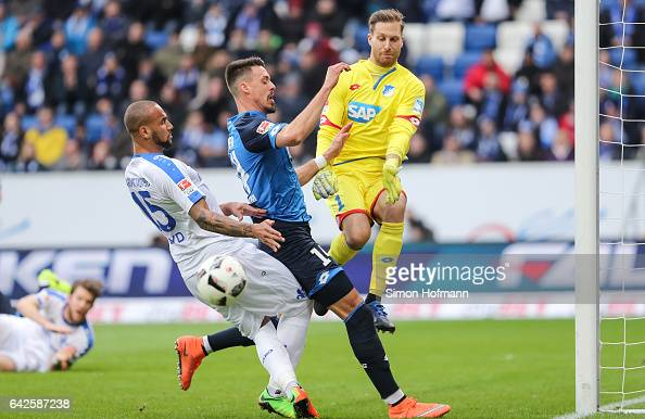 Terrence Boyd of Darmstadt tries to score against Sandro Wagner and goalkeeper Oliver Baumann of Hoffenheim during the Bundesliga match between TSG...