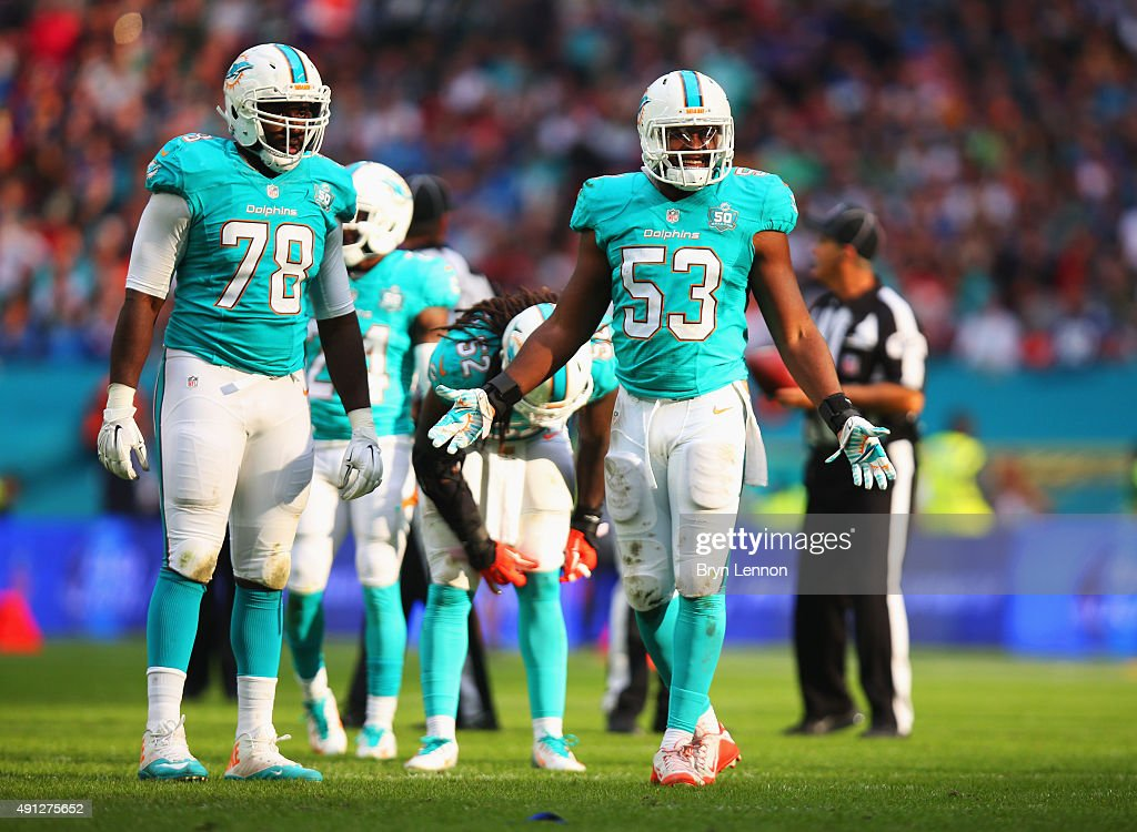 <a gi-track='captionPersonalityLinkClicked' href=/galleries/search?phrase=Terrence+Fede&family=editorial&specificpeople=12849843 ng-click='$event.stopPropagation()'>Terrence Fede</a> #78 of the Miami Dolphins and <a gi-track='captionPersonalityLinkClicked' href=/galleries/search?phrase=Jelani+Jenkins&family=editorial&specificpeople=5653455 ng-click='$event.stopPropagation()'>Jelani Jenkins</a> #53 of the Miami Dolphins react during the game against New York Jets at Wembley Stadium on October 4, 2015 in London, England.
