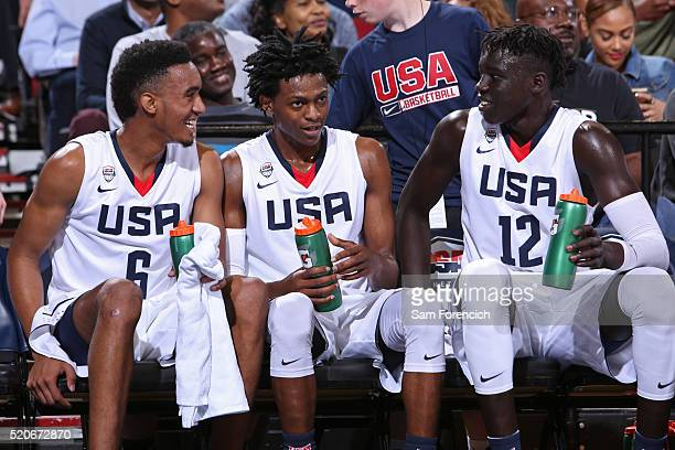 Terrence Ferguson and Wenyen Gabriel of the USA Junior Select Team smile and sit on the bench during the game against the World Select Team during...