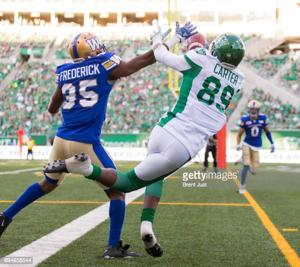 Terrence Frederick of the Winnipeg Blue Bombers breaks up a pass intended for Duron Carter of the Saskatchewan Roughriders in the preseason game...
