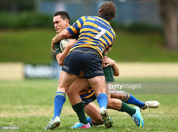 Terrence Hepetema of Randwick is tackled during the round nine Shute Shield match between Sydney University and Randwick at University Oval No 1 on...