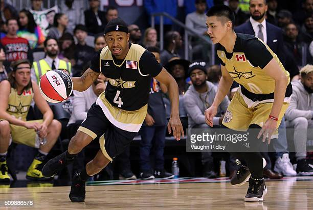 Terrence Jenkins of Team USA dribbles the ball as Kris Wu of Team Canada defends during the NBA AllStar Celebrity Game at the Ricoh Coliseum on...