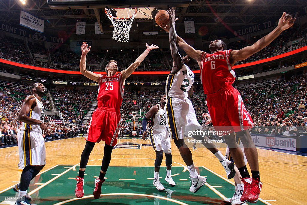 Terrence Jones #6 and Chandler Parsons #25 of the Houston Rockets try for a rebound against Marvin Williams #2 of the Utah Jazz at Energy Solutions Arena on November 19, 2012 in Salt Lake City, Utah.