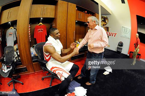 Terrence Jones and Leslie Alexander of the Houston Rockets celebrate in the locker room after a game against the Dallas Mavericks in Game Five of the...