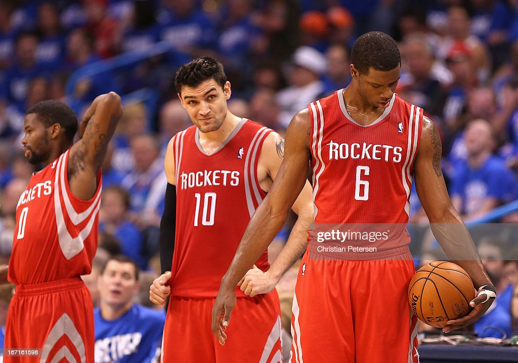 Terrence Jones #6, Carlos Delfino #10 and Aaron Brooks #0 of the Houston Rockets react during the second half of Game One of the Western Conference Quarterfinals of the 2013 NBA Playoffs against the Oklahoma City Thunder at Chesapeake Energy Arena on April 21, 2013 in Oklahoma City, Oklahoma. The Thunder defeated the Rockets 120-91.