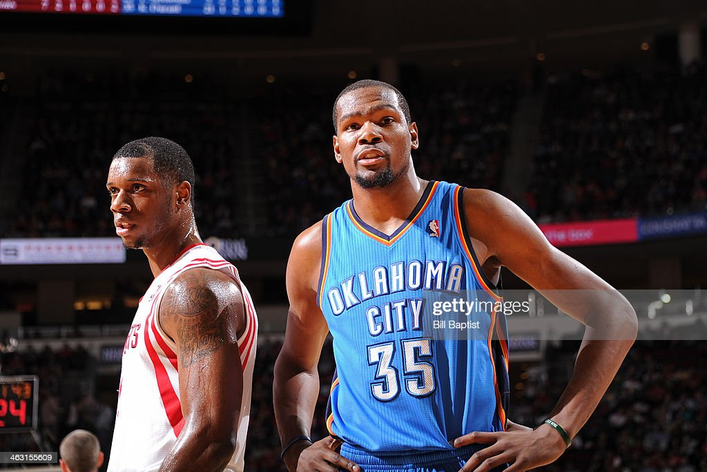 Terrence Jones #6 of the Houston Rockets and Kevin Durant #35 of the Oklahoma City Thunder react to a play on January 16, 2014 at the Toyota Center in Houston, Texas.