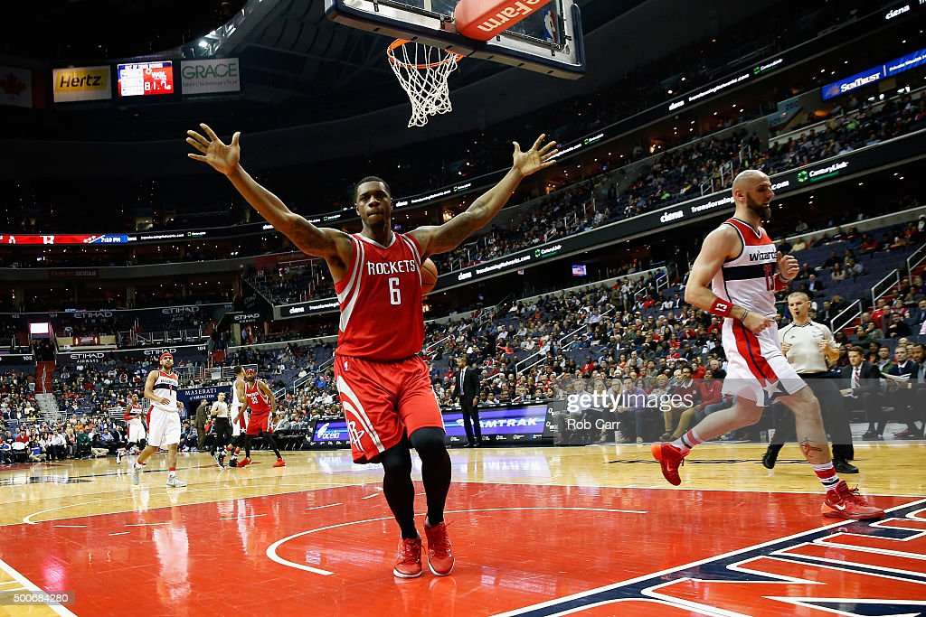 <a gi-track='captionPersonalityLinkClicked' href=/galleries/search?phrase=Terrence+Jones+-+Basketball+Player&family=editorial&specificpeople=7414659 ng-click='$event.stopPropagation()'>Terrence Jones</a> #6 of the Houston Rockets celebrates after dunking the ball in front of <a gi-track='captionPersonalityLinkClicked' href=/galleries/search?phrase=Marcin+Gortat&family=editorial&specificpeople=589986 ng-click='$event.stopPropagation()'>Marcin Gortat</a> #13 of the Washington Wizards in the first half at Verizon Center on December 9, 2015 in Washington, DC.