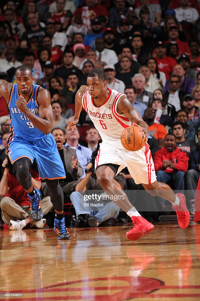 Terrence Jones #6 of the Houston Rockets dribbles the ball up court against the Oklahoma City Thunder on January 16, 2014 at the Toyota Center in Houston, Texas.