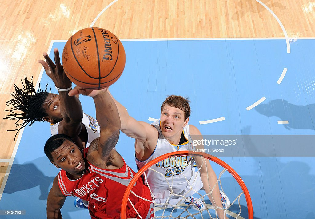 Terrence Jones #6 of the Houston Rockets dunks against <a gi-track='captionPersonalityLinkClicked' href=/galleries/search?phrase=Timofey+Mozgov&family=editorial&specificpeople=3949705 ng-click='$event.stopPropagation()'>Timofey Mozgov</a> #25 of the Denver Nuggets on April 9, 2014 at the Pepsi Center in Denver, Colorado.