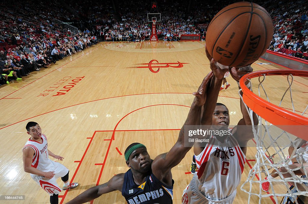 Terrence Jones #6 of the Houston Rockets dunks the ball against <a gi-track='captionPersonalityLinkClicked' href=/galleries/search?phrase=Zach+Randolph&family=editorial&specificpeople=201595 ng-click='$event.stopPropagation()'>Zach Randolph</a> #50 of the Memphis Grizzlies on April 12, 2013 at the Toyota Center in Houston, Texas.