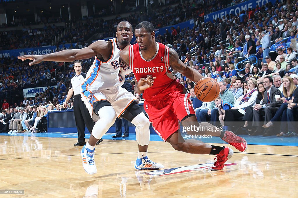 <a gi-track='captionPersonalityLinkClicked' href=/galleries/search?phrase=Terrence+Jones+-+Basketball+Player&family=editorial&specificpeople=7414659 ng-click='$event.stopPropagation()'>Terrence Jones</a> #6 of the Houston Rockets handles the ball against the Oklahoma City Thunder during an NBA game on March 11, 2014 at the Chesapeake Energy Arena in Oklahoma City, Oklahoma.