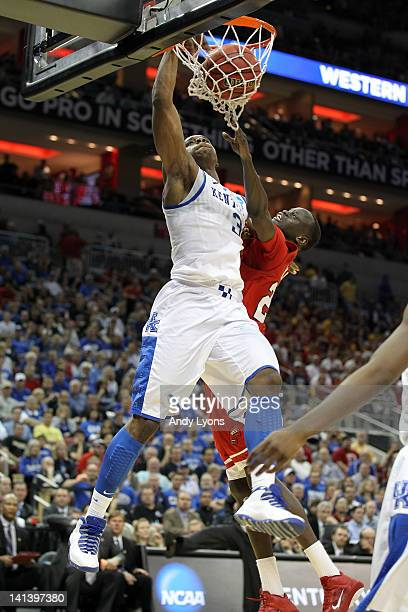 Terrence Jones of the Kentucky Wildcats dunks in the second half against Teeng Akol of the Western Kentucky Hilltoppers during the second round of...
