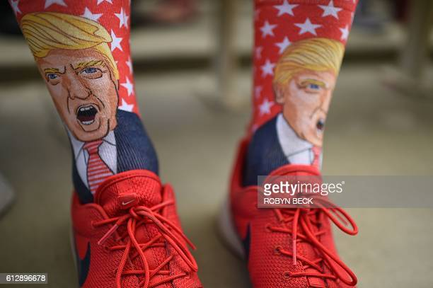 Terrence O'Hagan from Mission Viejo California wears socks decorated with an image of Republican presidential candidate Donald Trump during a...