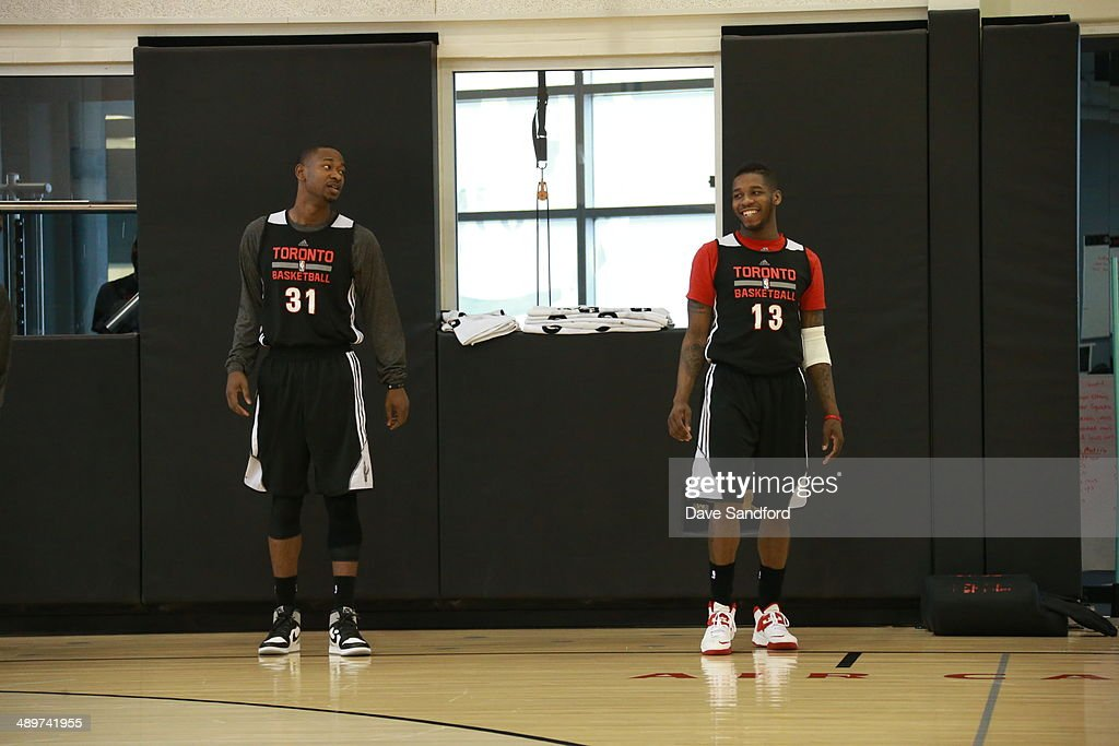 <a gi-track='captionPersonalityLinkClicked' href=/galleries/search?phrase=Terrence+Ross&family=editorial&specificpeople=6781663 ng-click='$event.stopPropagation()'>Terrence Ross</a> #31 and <a gi-track='captionPersonalityLinkClicked' href=/galleries/search?phrase=Dwight+Buycks&family=editorial&specificpeople=6699182 ng-click='$event.stopPropagation()'>Dwight Buycks</a> #13 of the Toronto Raptors smile during their NBA practice at the Air Canada Centre on April 18, 2014 in Toronto, Ontario, Canada.