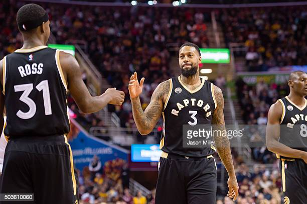 Terrence Ross celebrates with James Johnson of the Toronto Raptors during the first half at Quicken Loans Arena on January 4 2016 in Cleveland Ohio...