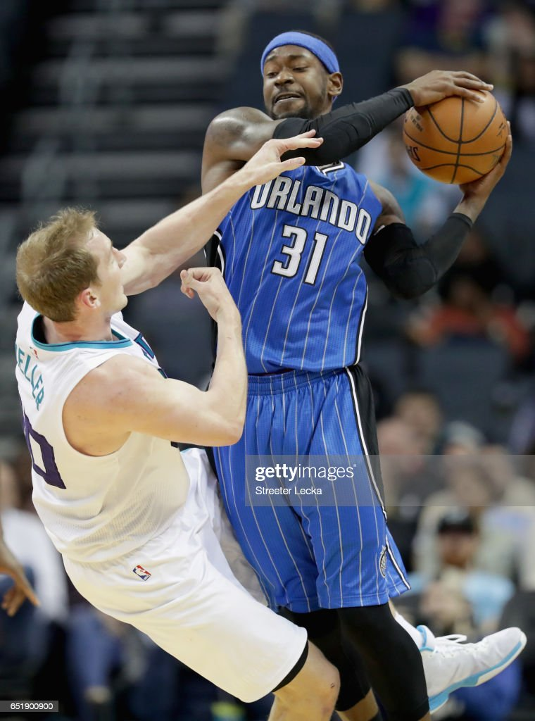 Terrence Ross #31 of the Orlando Magic collides with Cody Zeller #40 of the Charlotte Hornets during their game at Spectrum Center on March 10, 2017 in Charlotte, North Carolina.