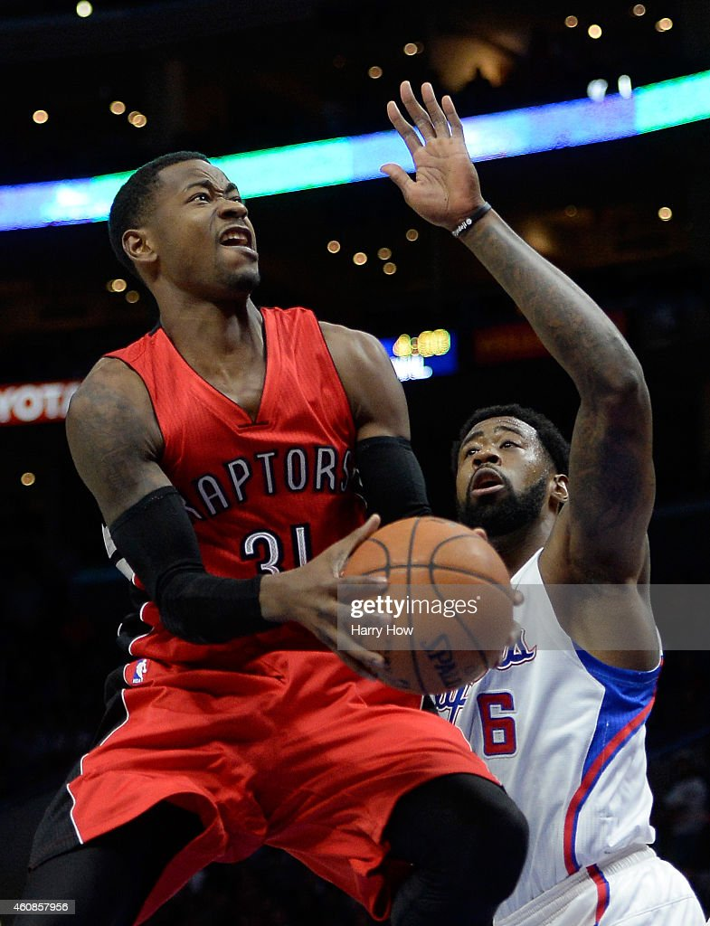 <a gi-track='captionPersonalityLinkClicked' href=/galleries/search?phrase=Terrence+Ross&family=editorial&specificpeople=6781663 ng-click='$event.stopPropagation()'>Terrence Ross</a> #31 of the Toronto Raptors attempts a shot in front of <a gi-track='captionPersonalityLinkClicked' href=/galleries/search?phrase=DeAndre+Jordan&family=editorial&specificpeople=4665718 ng-click='$event.stopPropagation()'>DeAndre Jordan</a> #6 of the Los Angeles Clippers during the first half at Staples Center on December 27, 2014 in Los Angeles, California.