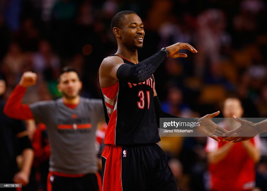 Terrence Ross #31 of the Toronto Raptors celebrates his three-point shot with teammates in the second half against the Boston Celtics during the game at TD Garden on March 26, 2014 in Boston, Massachusetts.
