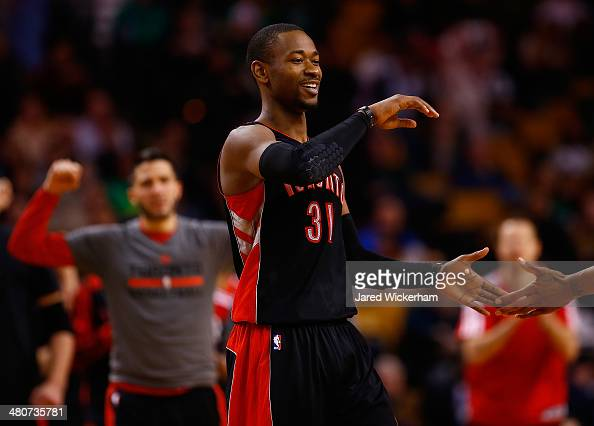 Terrence Ross of the Toronto Raptors celebrates his threepoint shot with teammates in the second half against the Boston Celtics during the game at...