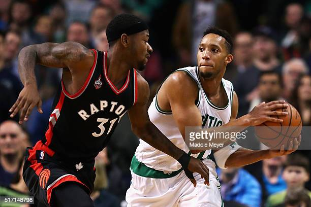 Terrence Ross of the Toronto Raptors defends Evan Turner of the Boston Celtics during the fourth quarter at TD Garden on March 23 2016 in Boston...