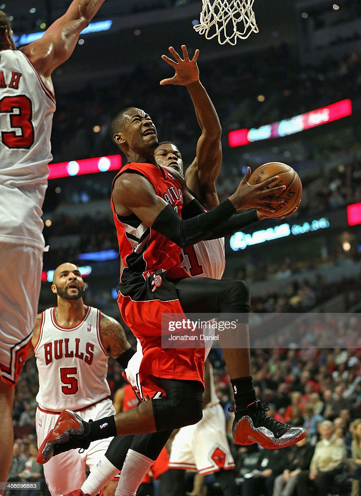 <a gi-track='captionPersonalityLinkClicked' href=/galleries/search?phrase=Terrence+Ross&family=editorial&specificpeople=6781663 ng-click='$event.stopPropagation()'>Terrence Ross</a> #31 of the Toronto Raptors dirves to the basket between <a gi-track='captionPersonalityLinkClicked' href=/galleries/search?phrase=Joakim+Noah&family=editorial&specificpeople=699038 ng-click='$event.stopPropagation()'>Joakim Noah</a> #13 and <a gi-track='captionPersonalityLinkClicked' href=/galleries/search?phrase=Jimmy+Butler+-+Basketball+Player&family=editorial&specificpeople=9860567 ng-click='$event.stopPropagation()'>Jimmy Butler</a> #21 of the Chicago Bulls at the United Center on December 14, 2013 in Chicago, Illinois.