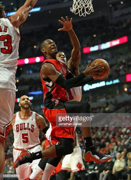 Terrence Ross of the Toronto Raptors dirves to the basket between Joakim Noah and Jimmy Butler of the Chicago Bulls at the United Center on December...