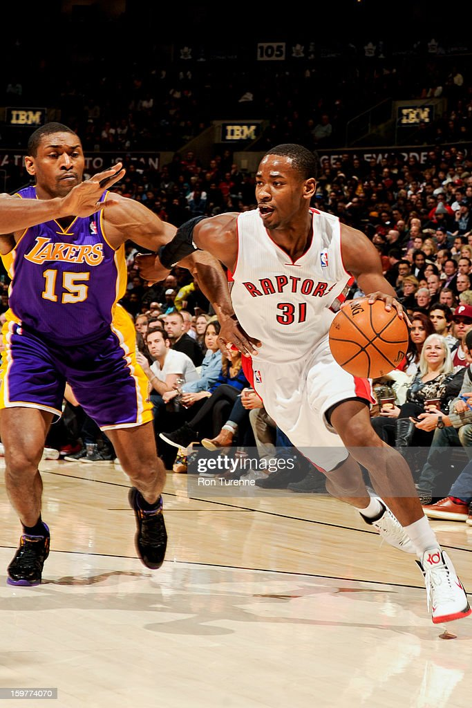 Terrence Ross #31 of the Toronto Raptors drives against Metta World Peace #15 of the Los Angeles Lakers on January 20, 2013 at the Air Canada Centre in Toronto, Ontario, Canada.
