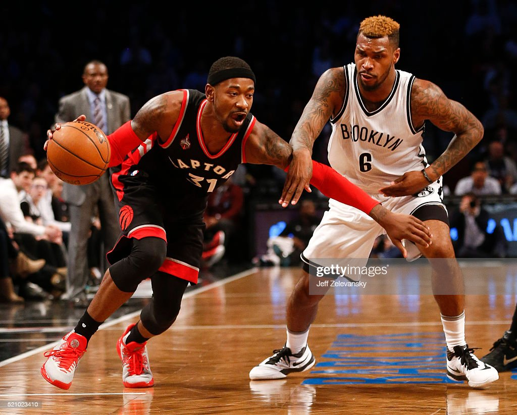 <a gi-track='captionPersonalityLinkClicked' href=/galleries/search?phrase=Terrence+Ross&family=editorial&specificpeople=6781663 ng-click='$event.stopPropagation()'>Terrence Ross</a> #31 of the Toronto Raptors drives by <a gi-track='captionPersonalityLinkClicked' href=/galleries/search?phrase=Sean+Kilpatrick&family=editorial&specificpeople=7444970 ng-click='$event.stopPropagation()'>Sean Kilpatrick</a> #6 of the Brooklyn Nets during their game at the Barclays Center on April 13, 2016 in New York City.