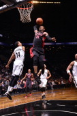 Terrence Ross of the Toronto Raptors drives to the basket and dunks the ball against the Brooklyn Nets on March 10 2014 at the Barclays Center in...