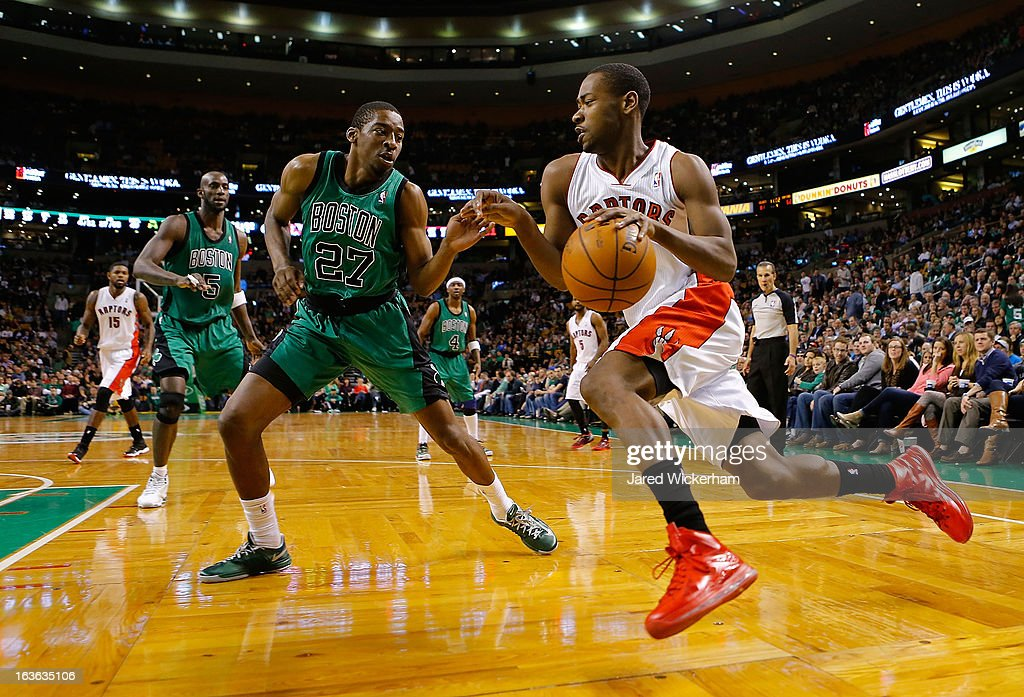 Terrence Ross #31 of the Toronto Raptors drives to the basket in front of Jordan Crawford #27 of the Boston Celtics during the game on March 13, 2013 at TD Garden in Boston, Massachusetts.