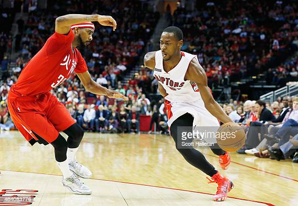 Terrence Ross of the Toronto Raptors drives with the basketball against Corey Brewer of the Houston Rockets during their game at the Toyota Center on...