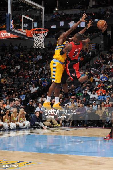 Terrence Ross of the Toronto Raptors dunks against the Denver Nuggets on January 31 2014 at the Pepsi Center in Denver Colorado NOTE TO USER User...