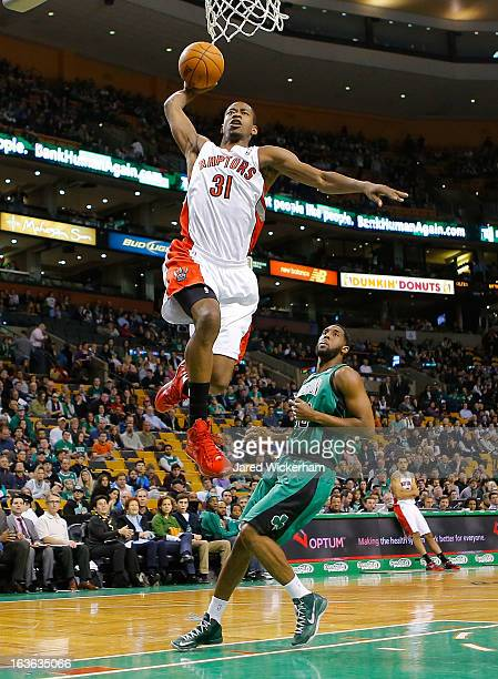 Terrence Ross of the Toronto Raptors dunks in front of DJ White of the Boston Celtics during the game on March 13 2013 at TD Garden in Boston...