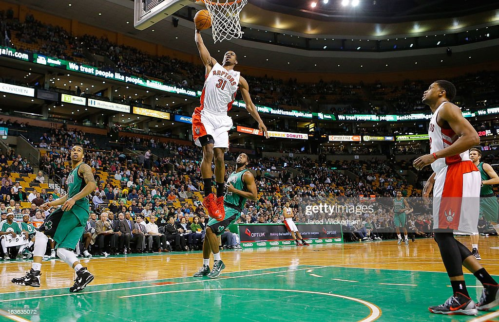 Terrence Ross #31 of the Toronto Raptors dunks in front of D.J. White #12 of the Boston Celtics during the game on March 13, 2013 at TD Garden in Boston, Massachusetts.