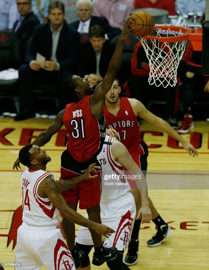 <a gi-track='captionPersonalityLinkClicked' href=/galleries/search?phrase=Terrence+Ross&family=editorial&specificpeople=6781663 ng-click='$event.stopPropagation()'>Terrence Ross</a> #31 of the Toronto Raptors dunks over Omer Asik #3 and <a gi-track='captionPersonalityLinkClicked' href=/galleries/search?phrase=Daequan+Cook&family=editorial&specificpeople=3847493 ng-click='$event.stopPropagation()'>Daequan Cook</a> #14 of the Houston Rockets at the Toyota Center on November 27, 2012 in Houston, Texas.