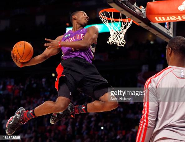 Terrence Ross of the Toronto Raptors dunks the ball after a pass from teammate Terrence Jones during the Sprite Slam Dunk Contest part of 2013 NBA...