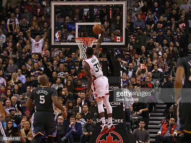 Terrence Ross of the Toronto Raptors dunks the ball against the Golden State Warriors on December 5 2015 at Air Canada Centre in Toronto Ontario...