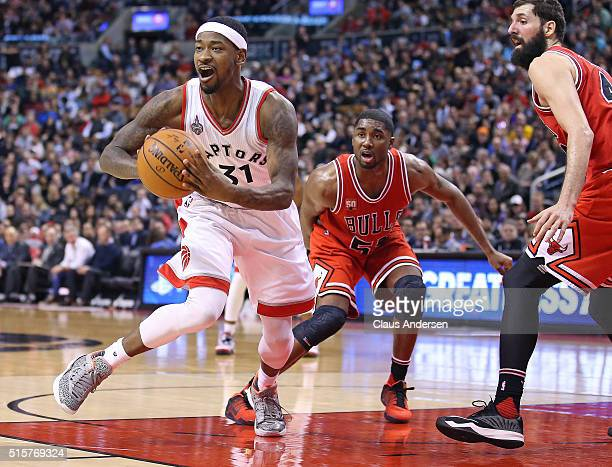 Terrence Ross of the Toronto Raptors gets set to make a pass against the Chicago Bulls during an NBA game at the Air Canada Centre on March 14 2016...