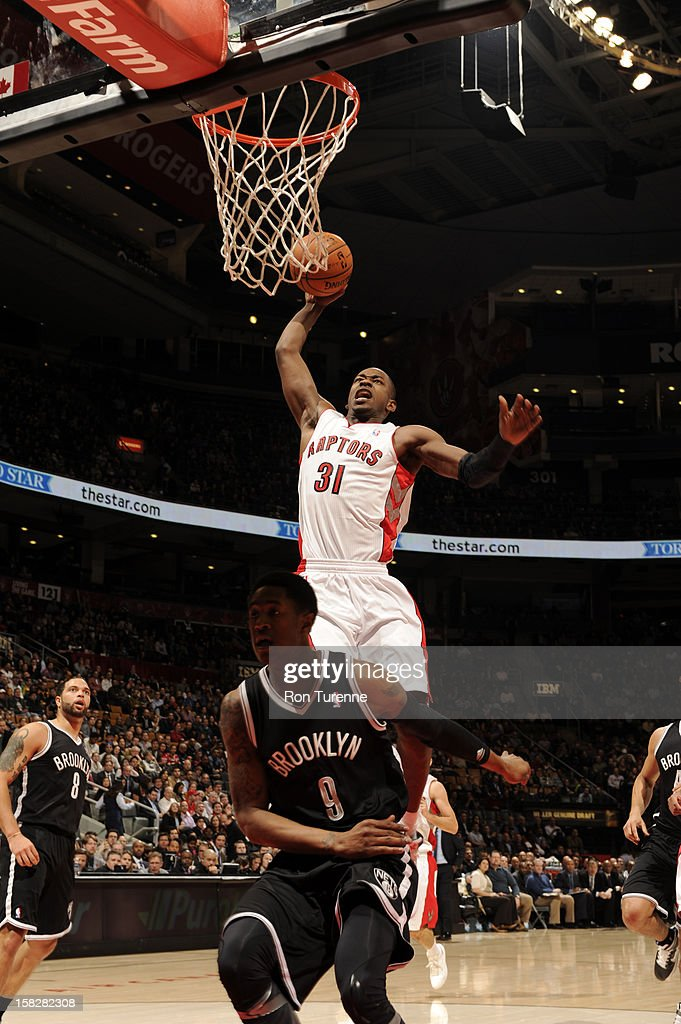 Terrence Ross #31 of the Toronto Raptors goes to the basket against MarShon Brooks #9 of the Brooklyn Nets on December 12, 2012 at the Air Canada Centre in Toronto, Ontario, Canada.