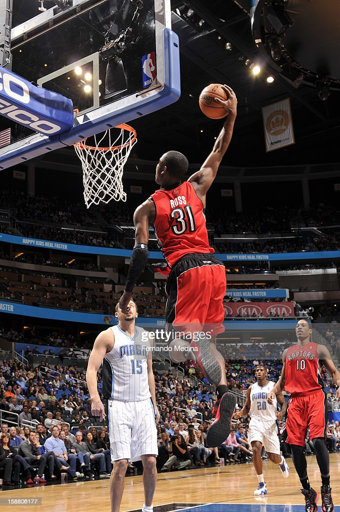 Terrence Ross #31 of the Toronto Raptors goes up for the slam-dunk against the Orlando Magic during the game on December 29, 2012 at Amway Center in Orlando, Florida.