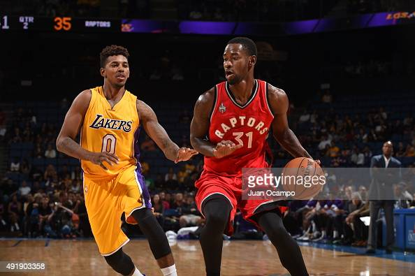 Terrence Ross of the Toronto Raptors handles the ball against Nick Young of the Los Angeles Lakers during a preseason game on October 8 2015 at...