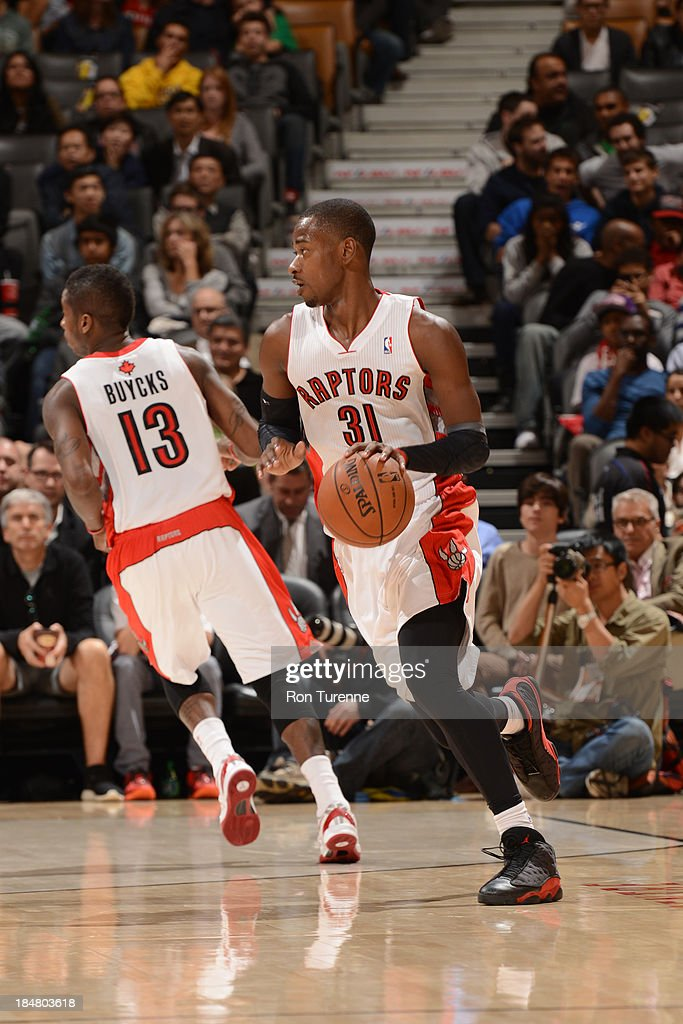 <a gi-track='captionPersonalityLinkClicked' href=/galleries/search?phrase=Terrence+Ross&family=editorial&specificpeople=6781663 ng-click='$event.stopPropagation()'>Terrence Ross</a> #31 of the Toronto Raptors handles the ball against the Boston Celtics during the game on October 16, 2013 at the Air Canada Centre in Toronto, Ontario, Canada.