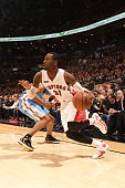 Terrence Ross of the Toronto Raptors handles the ball against the Denver Nuggets during the game on December 8 2014 at the Air Canada Centre in...
