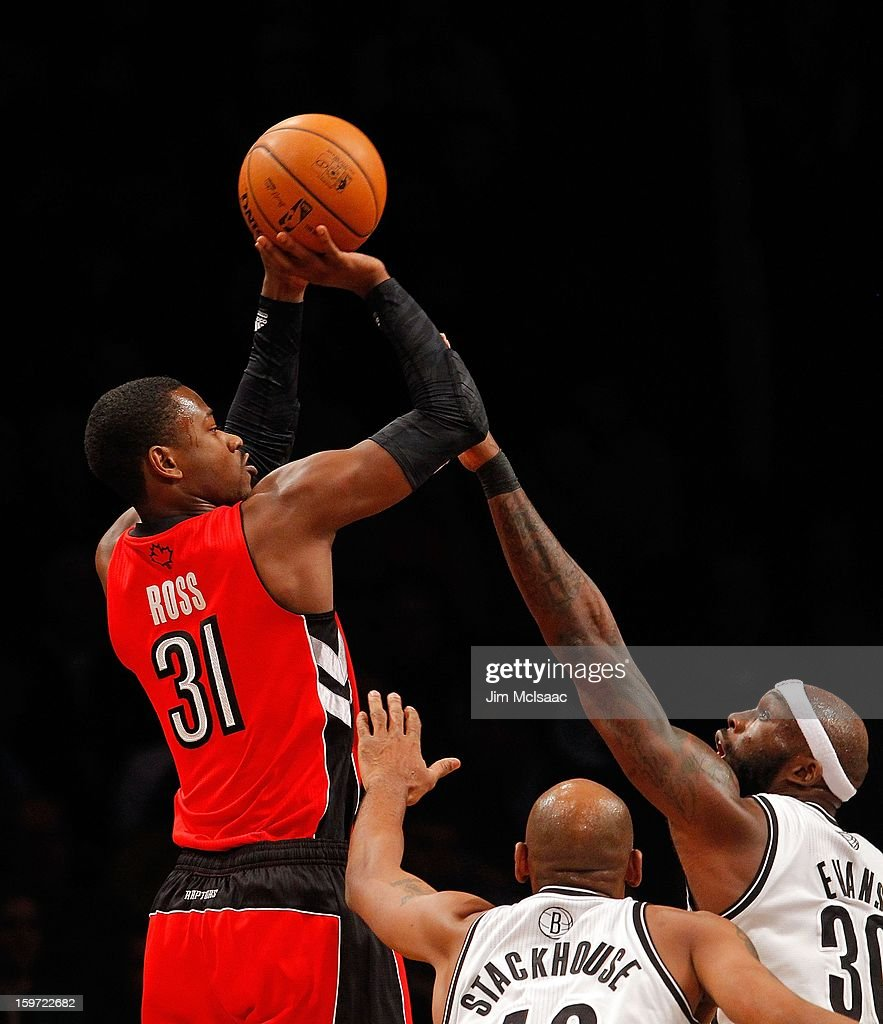 Terrence Ross #31 of the Toronto Raptors in action against Jerry Stackhouse #42 and Reggie Evans #30 of the Brooklyn Nets at Barclays Center on January 15, 2013 in the Brooklyn borough of New York City.The Nets defeated the Raptors 113-106.