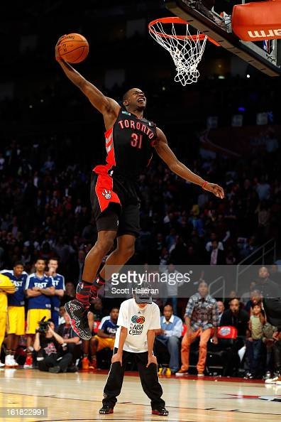Terrence Ross of the Toronto Raptors jumps over a ball kid in his final dunk during the Sprite Slam Dunk Contest part of 2013 NBA AllStar Weekend at...