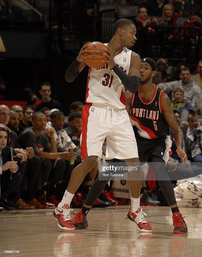 <a gi-track='captionPersonalityLinkClicked' href=/galleries/search?phrase=Terrence+Ross&family=editorial&specificpeople=6781663 ng-click='$event.stopPropagation()'>Terrence Ross</a> #31 of the Toronto Raptors looks to pass the ball against the Portland Trail Blazers during the game on January 2, 2013 at the Air Canada Centre in Toronto, Ontario, Canada.