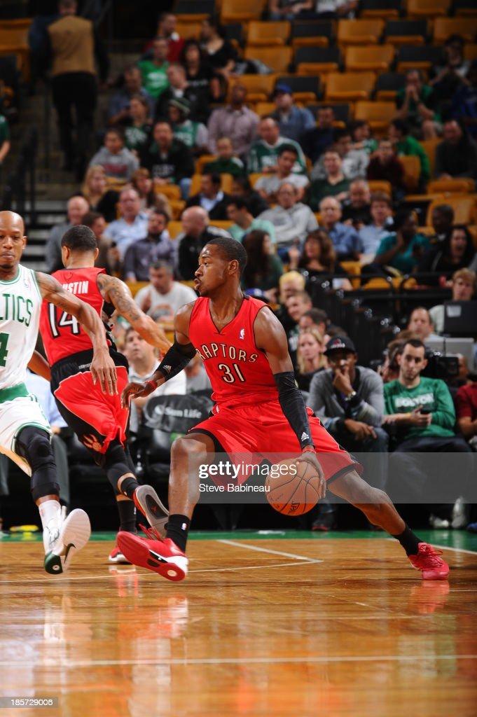Terrence Ross #31 of the Toronto Raptors looks to pass the ball against the Boston Celtics on October 7, 2013 at the TD Garden in Boston, Massachusetts.