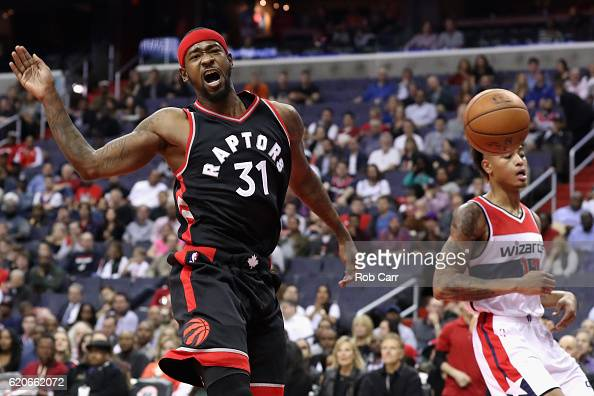 Terrence Ross of the Toronto Raptors reacts after dunking over Kelly Oubre Jr #12 of the Washington Wizards in the first half at Verizon Center on...